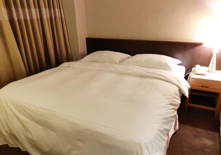 シティスイーツ桃園ゲートウェイ(City Suites - Taoyuan Gateway) 客室のベッド