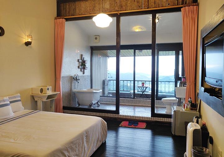 九份 サニールーム(陽光味宿)の客室のベッドルーム